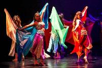 Middle Eastern dance performers with scarves