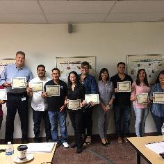 Excel training group holding certificates of completion