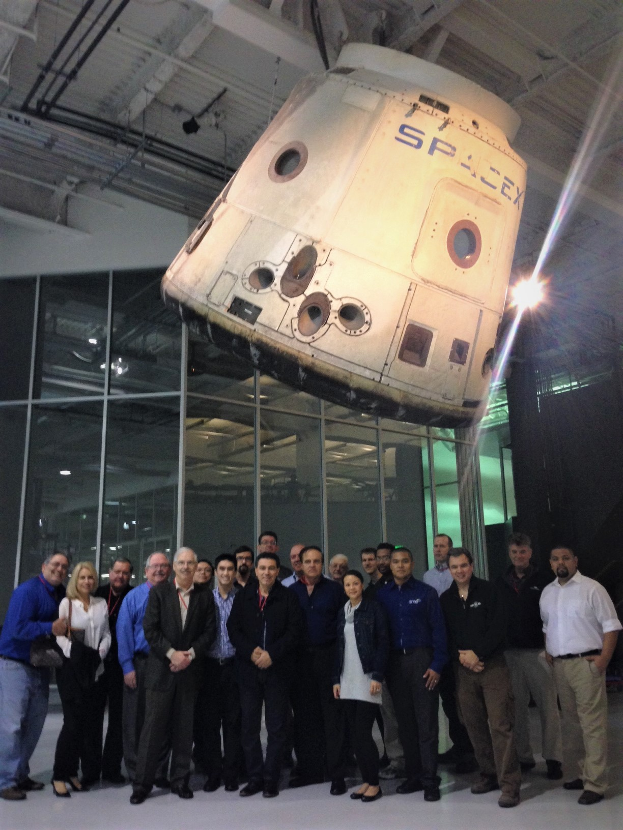 A group of men and women visiting SpacX company