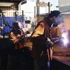 men welding work in action