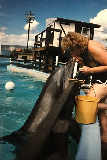 Sandy with a dolphin