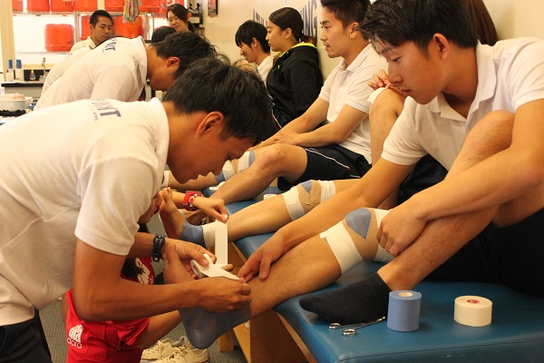 Japanese student learning taping technique