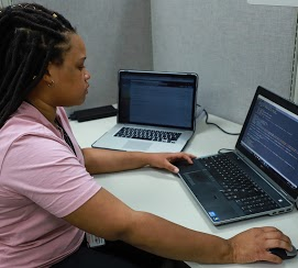 Female individual working at a computer station