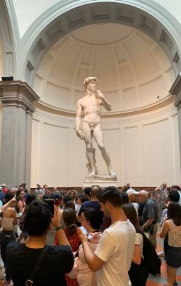 Students viewing Michelangelo's David