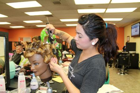 Student working on a hairstyle