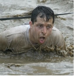 Instructor Ramos swimming in watery mud