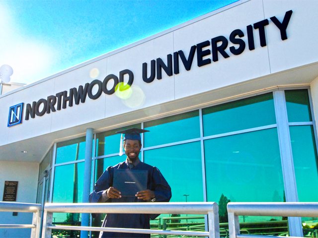 Graduate in front of Northwood University