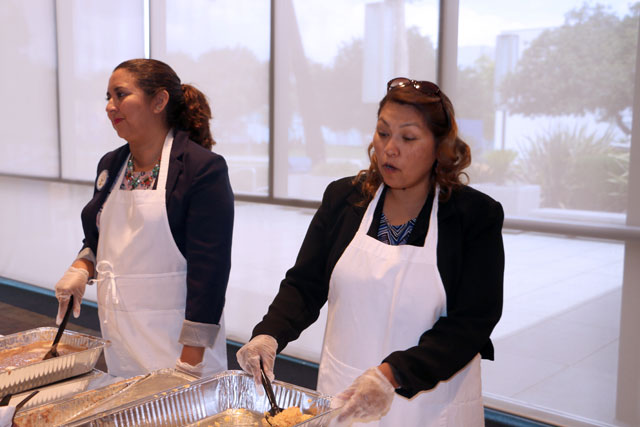 Marisa Perez and Carmen Avalos serving food