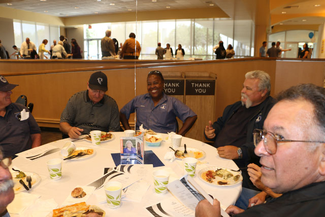 Facilities staff and Frank Mazzotta enjoying food and discussion