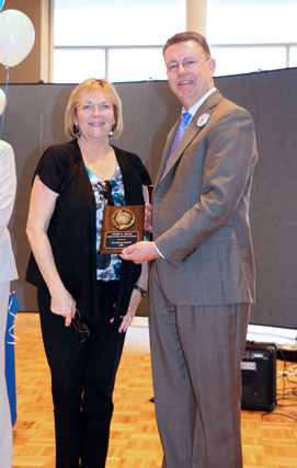 Dr. Stephen Johnson presents award plaque to Karen Boyce