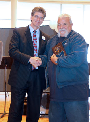David El Fattel presents award plaque to Joe Hunt