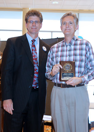 David El Fattel presents award plaque to Roger Adams