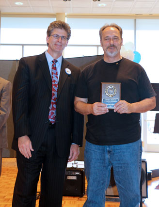 David El Fattel presents award placque to Dave Mussaw