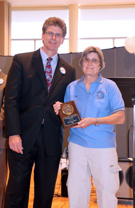 David El Fattel presents award plaque to Patricia McKinley