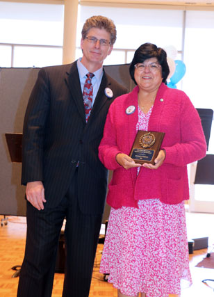 David El Fattel presents award placque to Arlene Belknap