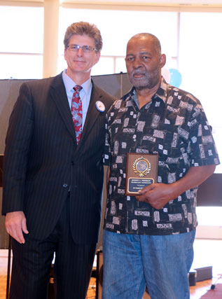 David El Fattel presents award placque to Lamont Freeman