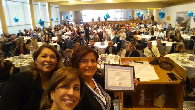 Lucy Romero's selfie with MaryAnne, Carmen, and the staff behind them.