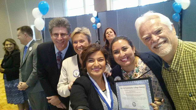 Lucy Romero selfie picture with Carmen Avalos, Dr. Stephen Jonson, David El Fattel, Dr. Linda Lacy, Marisa Perez, Bob Arthur.  Monica Acuna photobombs this photo.