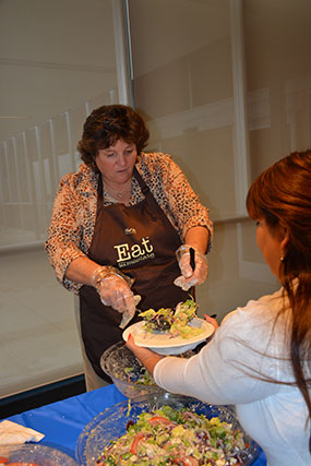 Sue Parsons serving food to classified staff.