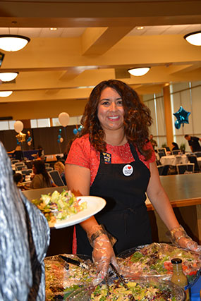 Marisa Perez, Cerritos College Trustee, prepares to serve food.