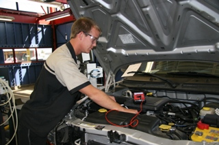 Automotive Student working on a Car